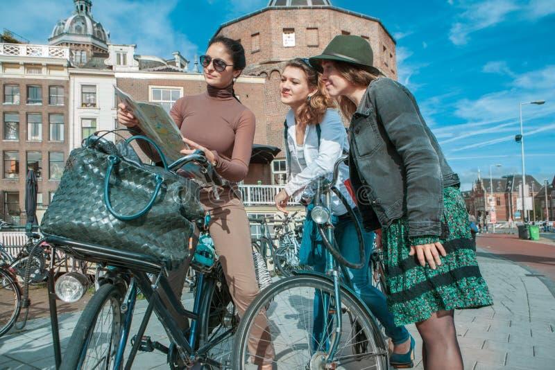 Three friends exploring Amsterdam royalty free stock image