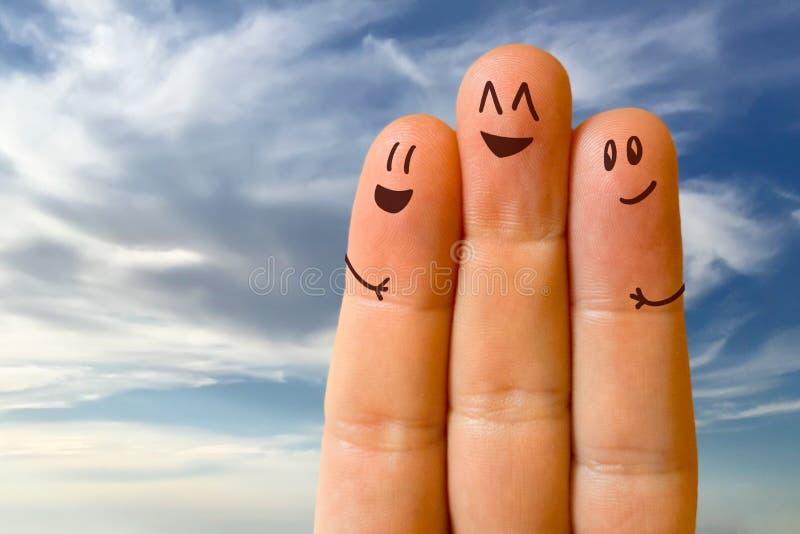 Three friends fingers stock image