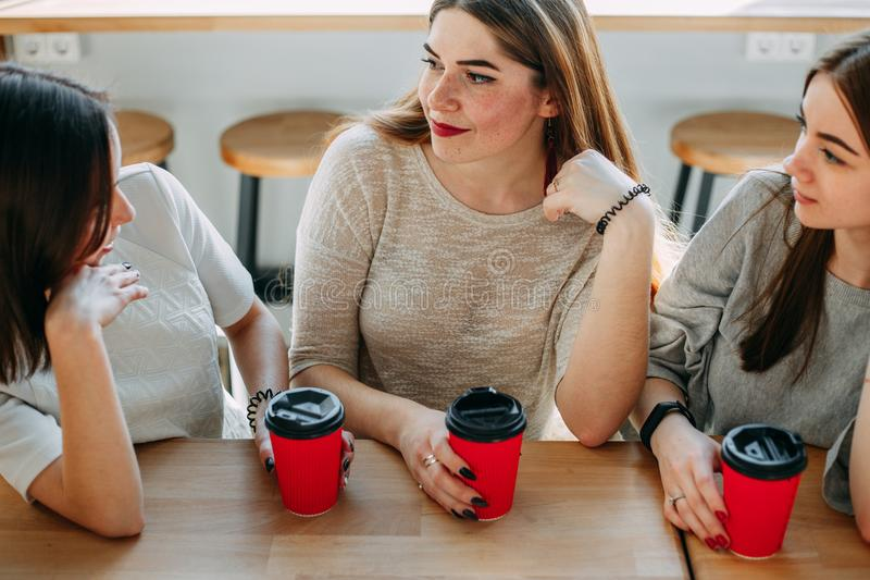 Three friends having a great time at cafe stock photography