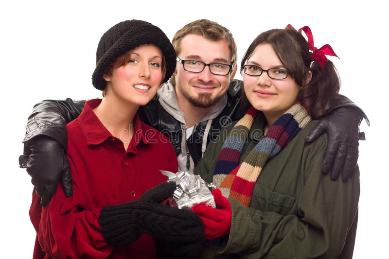 Three Friends Holding A Holiday Gift Isolated Stock Image