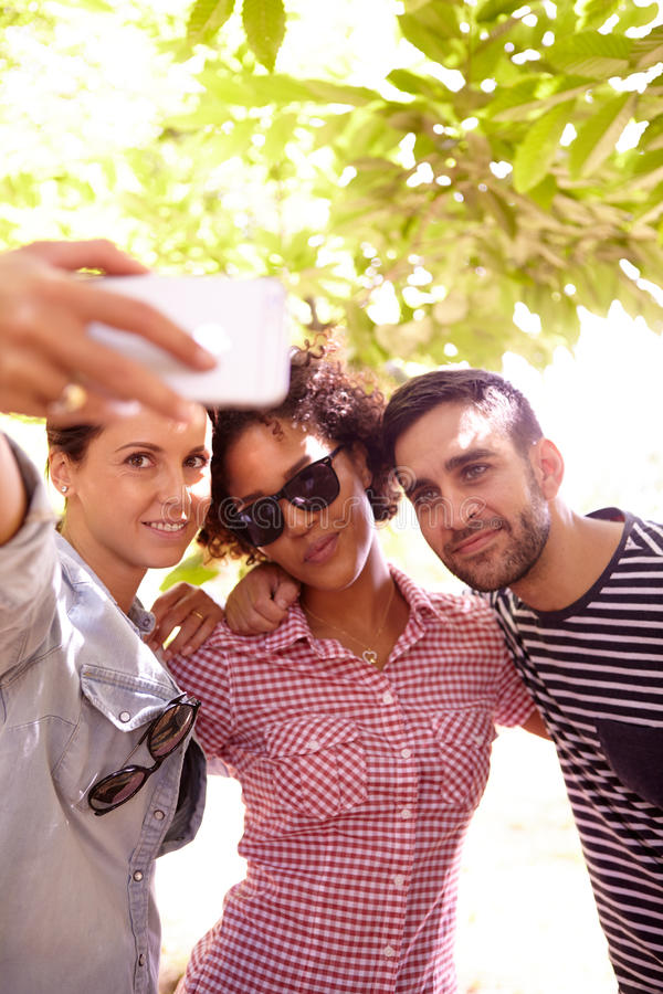 Three friends posing for a selfie royalty free stock images