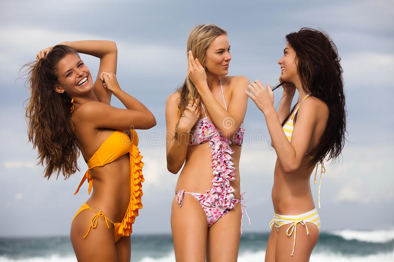Download Three Friends In Swimsuits At The Beach Stock Image - Image: 13460059