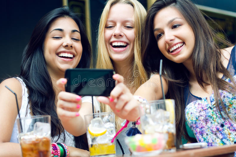 Download Three Friends Taking Photos With A Smartphone Stock Image - Image: 33134857
