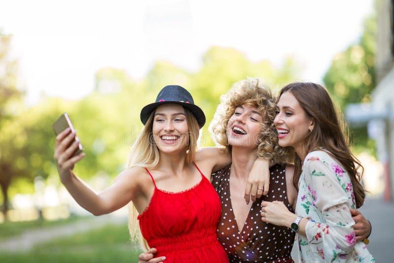 Three friends taking selfies royalty free stock image