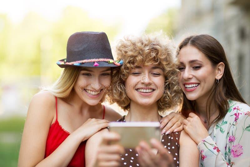 Three friends taking selfies royalty free stock photos
