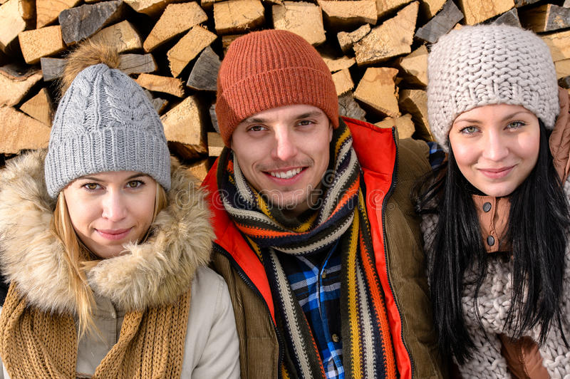 Three friends wearing winter clothes outdoor royalty free stock image