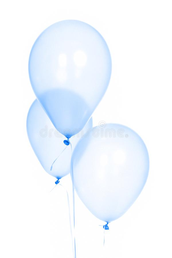 Three funny blue birthday balloons with white background royalty free stock images