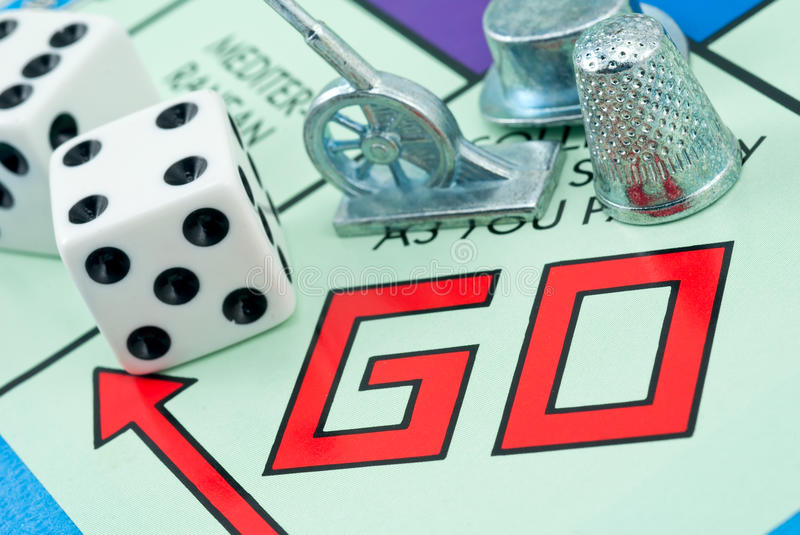 Three game pieces and two dice royalty free stock photos