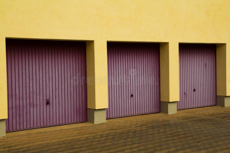 Download Three garage doors stock image. Image of southern, yellow - 26846049