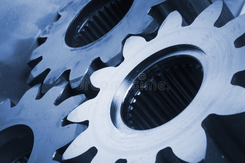 Three gear-wheels in blue. Three cogs in bluish tint stock photography