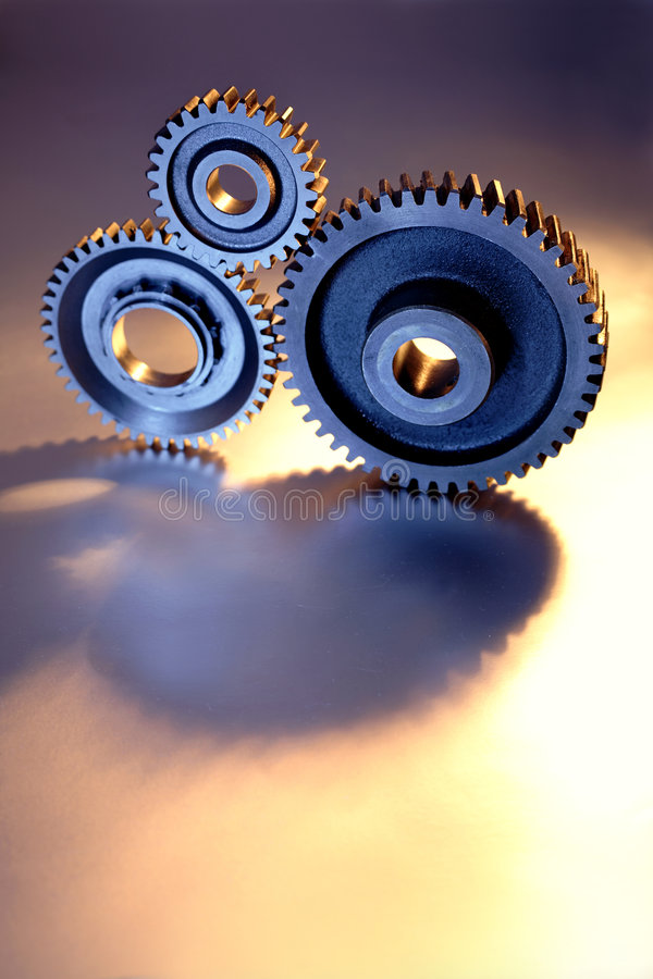 Three gears. Three metal gears working together royalty free stock photos