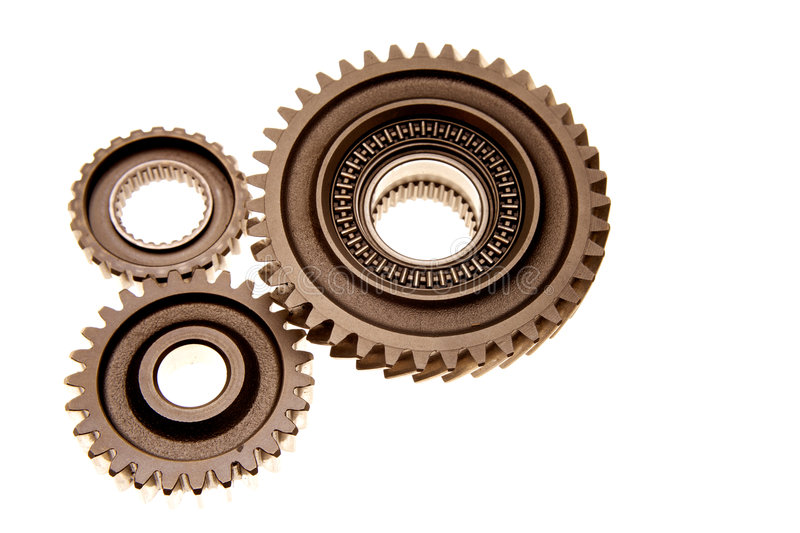 Three gears. Meshing together over white royalty free stock photos