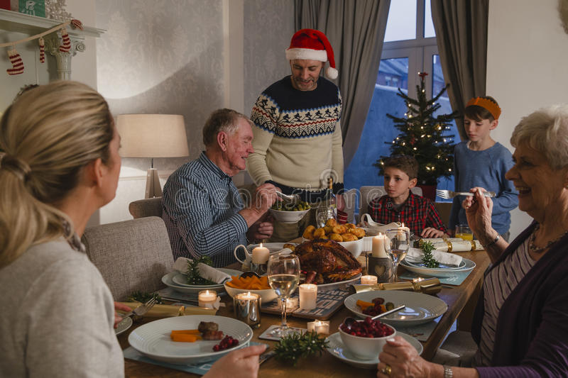 Three Generation Family Christmas Dinner stock photos