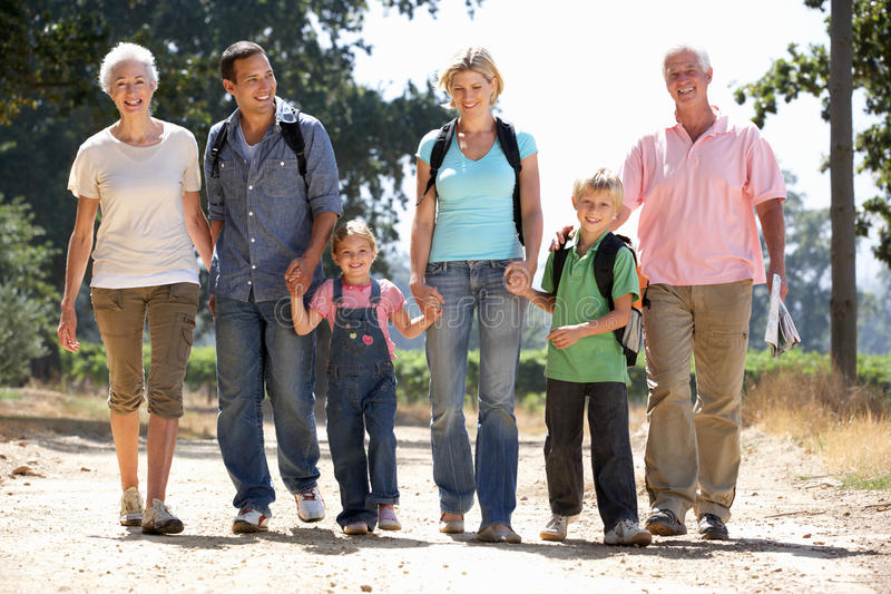 Three generation family on country walk stock images