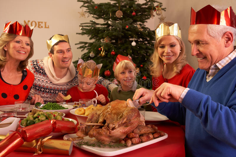 Three Generation Family Enjoying Christmas Meal stock photo