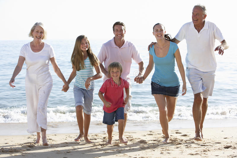 Three Generation Family Having Fun On Beach stock image