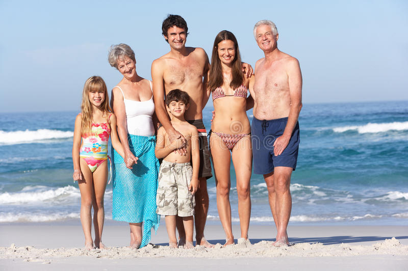 Three Generation Family On Holiday At The Beach stock photo