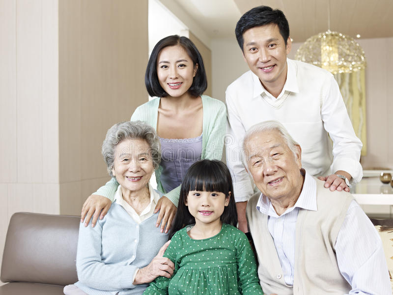 Three-generation family stock photos