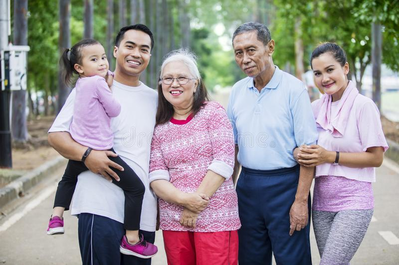 Three generation family standing on the road royalty free stock photos