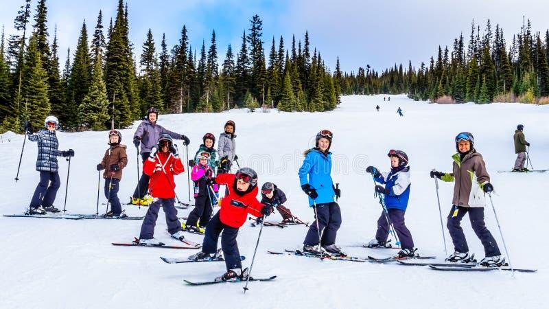 Three generation having fun skiing together at Sun Peaks. Ski resort in British Columbia, Canada royalty free stock image