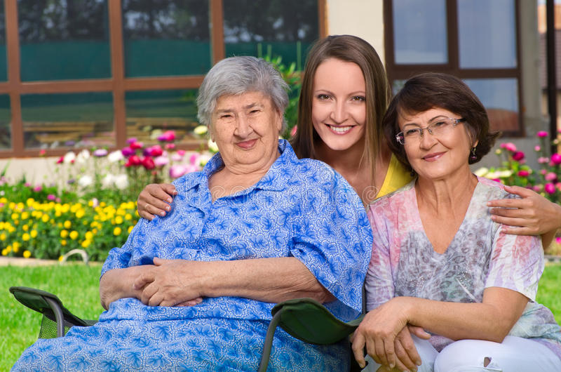 Three generation of women at countryside stock photo