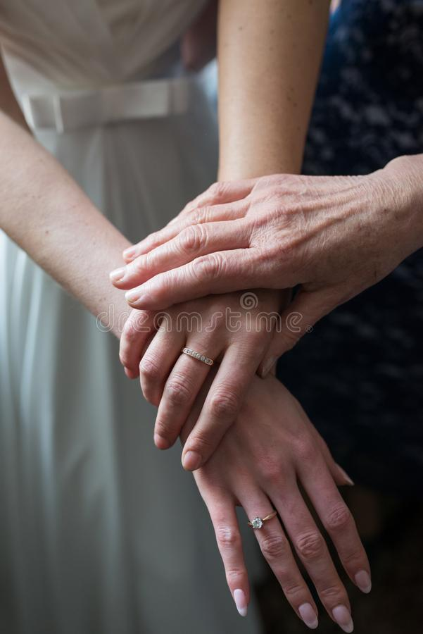 Three generations. Hands daughters, moms and grandmothers. Wedding royalty free stock images