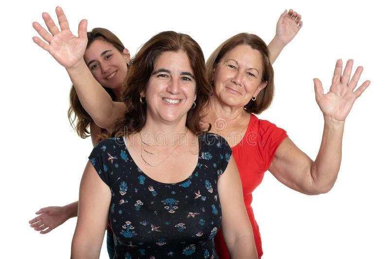 Three generations of hispanic women on a white background stock photography
