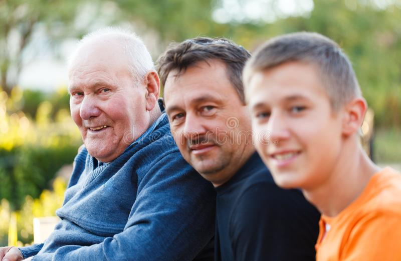 Three Generations Portrait. Portrait of three generations male family members together royalty free stock photo