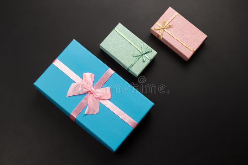 Three gift boxes on a black background ,holiday sales concept. Top view three gift boxes on a black background ,holiday sales concept royalty free stock images