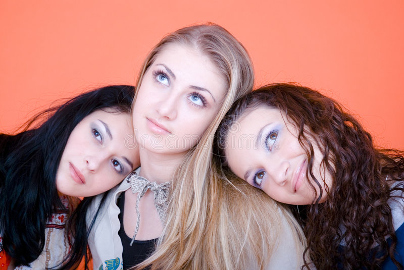 three girlfriends daydreaming royalty free stock photos