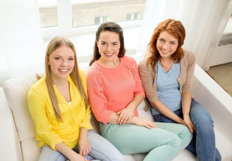 Three girlfriends having a talk at home royalty free stock photo