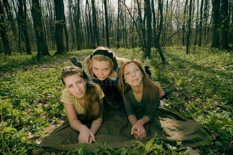 three girlfriends relaxing royalty free stock photo