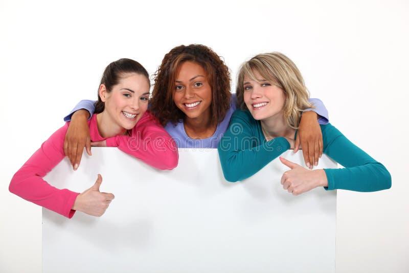 Three girls stock photos