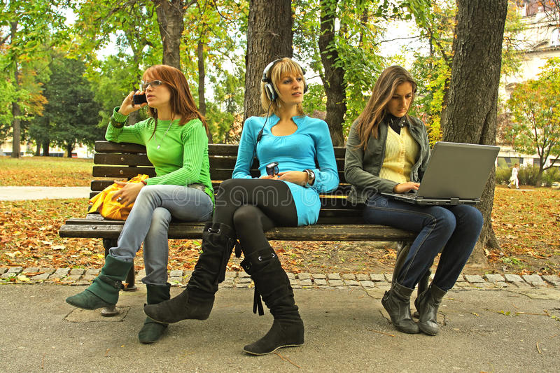 Download Three girls on a bench stock image. Image of bench, mobile - 11774035