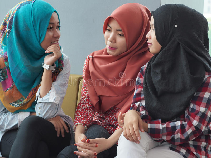 Three girls chatting stock images