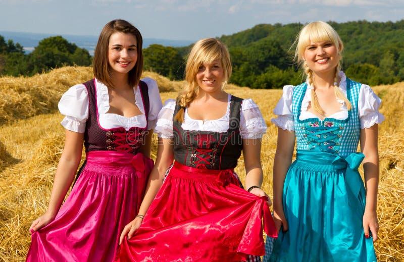 Three girls in Dirndl royalty free stock photo