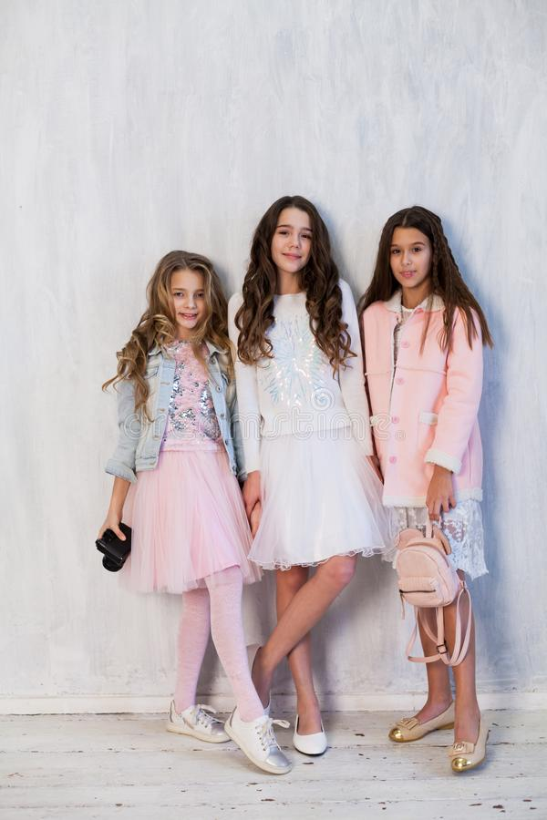 Three girls girlfriend photographer camera schoolgirl fashion. Three girls girlfriend photographer camera schoolgirl stock photo