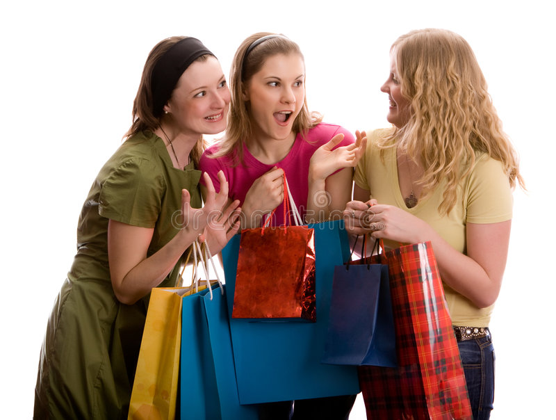 Three girls gossiping. Isolated on white
