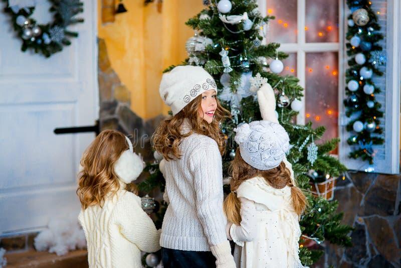 Three girls near a Christmas royalty free stock photography