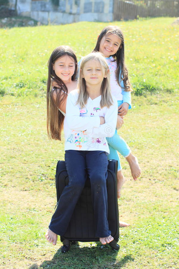 Download Three Girls Prepared For Traveling With Suitcase Stock Photo - Image: 33269102
