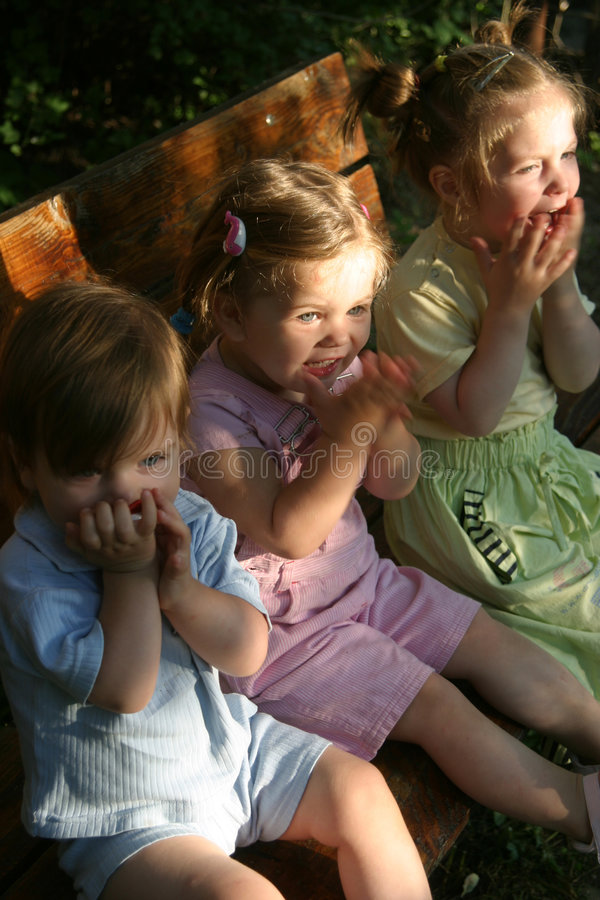 Three girls sitting outdoor stock photography
