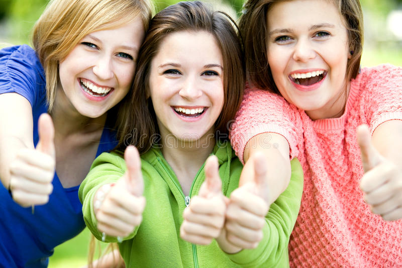 Download Three Girls With Thumbs Up Stock Image - Image: 20855401
