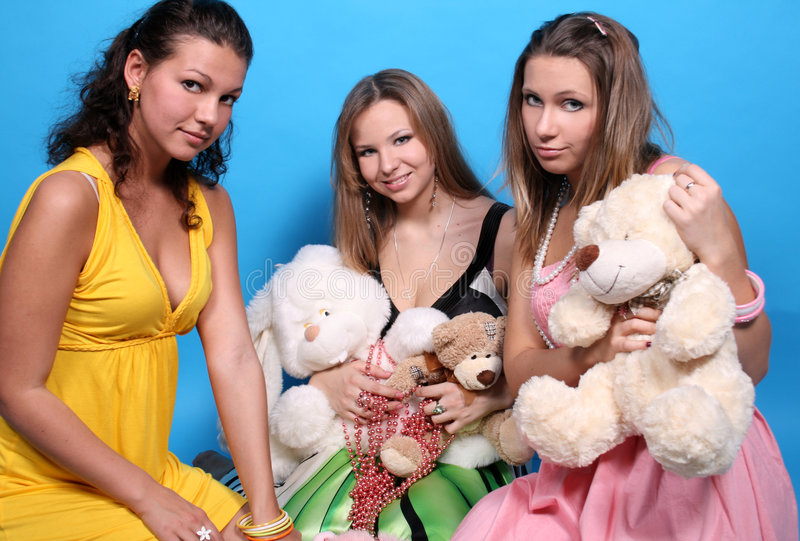 Download Three girls with toys stock image. Image of dress, brunet - 7653011