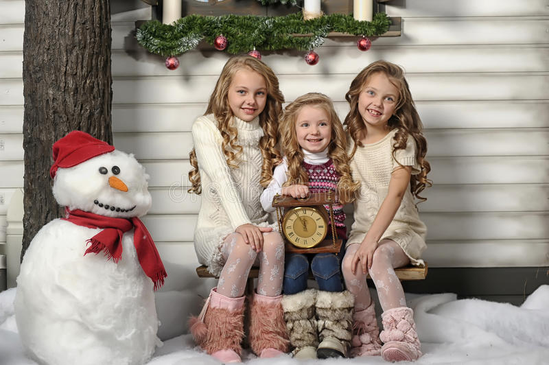 Three cute girls waiting for Christmas royalty free stock photography