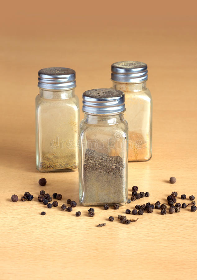 Three glass jars with spice royalty free stock photo