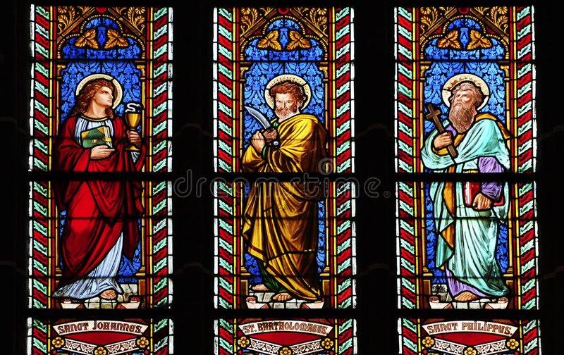 Three glass stained windows in church. With saint johannes, bartholomeus and philippus stock photo