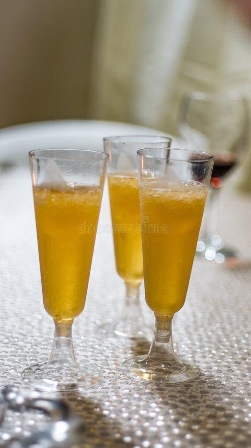 Three glasses of cider to drink and enjoy. Copas llenas de deliciosa sidra servida en la boda de cristanos stock photography
