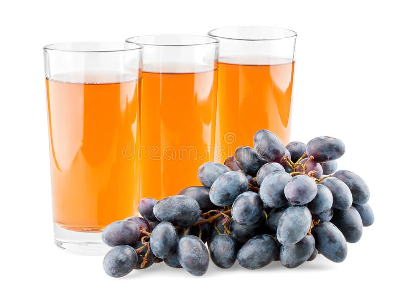 Three glasses of juice and branch of grapes royalty free stock image