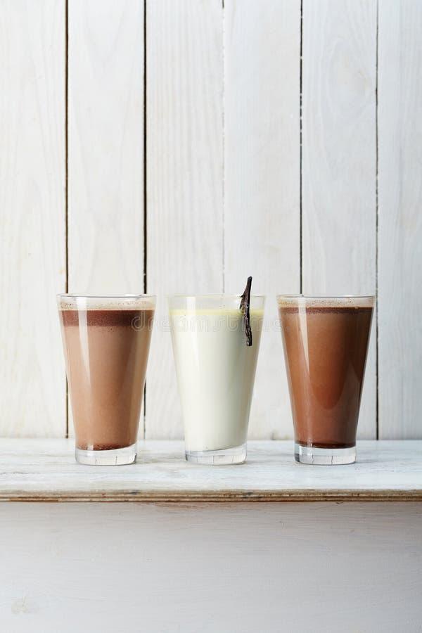Three glasses of milkshakes. On the white surface stock images
