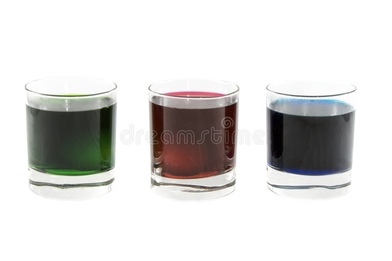 Three glasses with multi-coloured cocktails stock photos